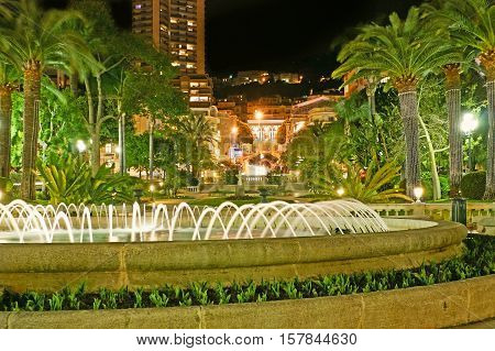 The nice fountains in French gardens of Monte Carlo stretching along the luxury hotels and splendid mansions Monaco.
