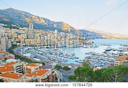 The nice view on the Hercules Port La Condamine and Monte Carlo wards surrounded by mountains from the viewpoint on the Rock of Monaco.