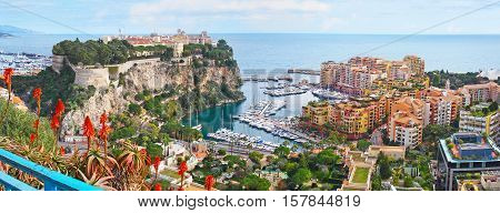 Panorama of Monaco coast with the medieval Monaco-Ville ward located on the Rock new port and the modern Fontvieille ward.