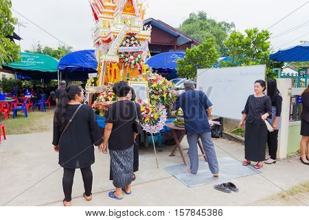 CHIANG RAI THAILAND - NOVEMBER 19 : unidentified Thai people participating traditional buddhist funeral on November 19 2016 in Chiang rai Thailand.