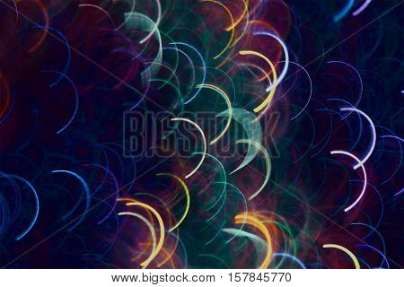 Photo by colored semicircular light lines as squama to abstract background.