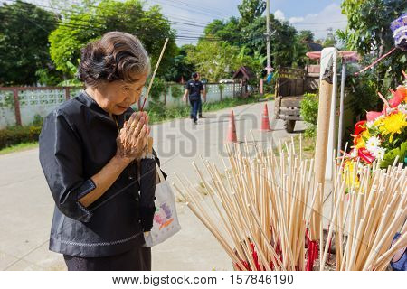 CHIANG RAI THAILAND - NOVEMBER 19 : unidentified Thai old woman participating traditional buddhist funeral on November 19 2016 in Chiang rai Thailand