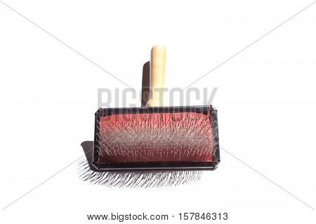 Slicker brush for cats with wool on white background
