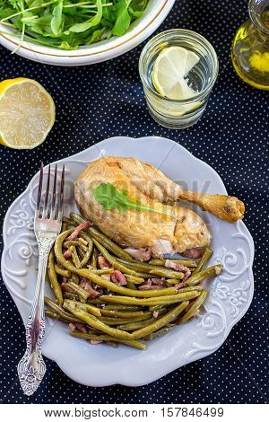 Spanish style green beans with ham served with chicken