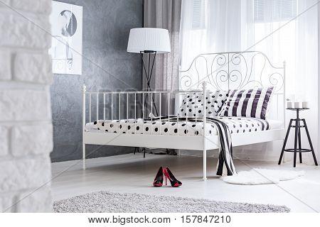 Feminine Bedroom With Metal Bed