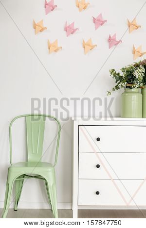 Mint Chair And White Commode.