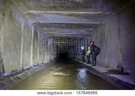 Diggers in underground river Neglinnaya flowing under Moscow.