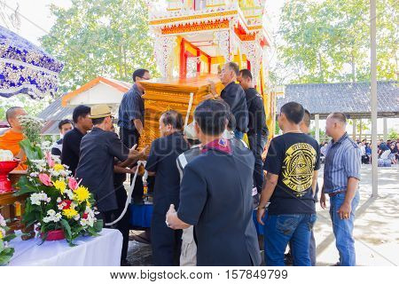 CHIANG RAI THAILAND - NOVEMBER 19 : unidentified Thai people trying to carry coffin to the crematory on November 19 2016 in Chiang rai Thailand