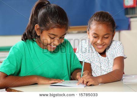 School girls in class learning