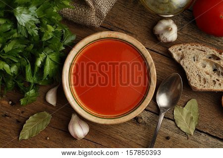 Tomato Cream Soup With Ingredients On Wooden Background. Top View