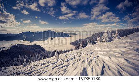 Deep Blue Sky Above Foggy Mountains.
