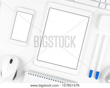 Top view: Keyboard tablet and smartphone on white table background with text space and copy space.