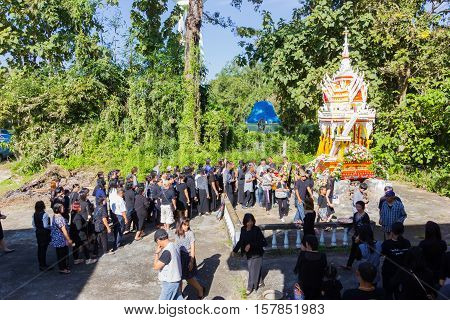 CHIANG RAI THAILAND - NOVEMBER 19 : unidentified people going to the crematory for saying good bye to the dead man in the coffin on November 19 2016 in Chiang rai Thailand