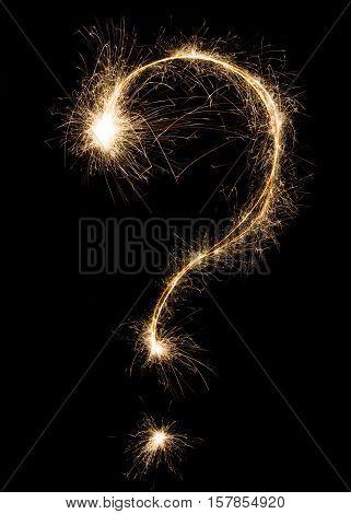 Question sign. Sparkler firework light alphabet punctuation mark, asking symbol on black background. Font pattern, sparkling text