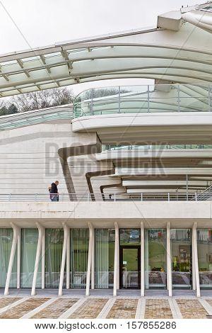 LIEGE BELGIUM - December 2014: Travellers walking on Level 01 of the Liege-Guillemins railway station designed by Santiago Calatrava.