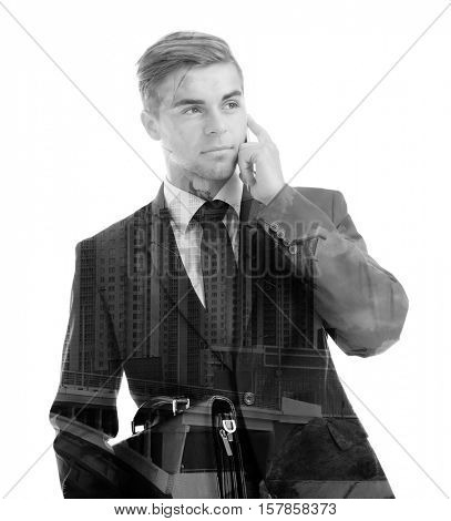 Double exposure of man talking on phone and building on white background. Business concept. Black and white photo.
