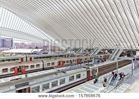 LIEGE BELGIUM - December 2014: Platform with people waiting for the train in the Liege-Guillemins railway station designed by Santiago Calatrava