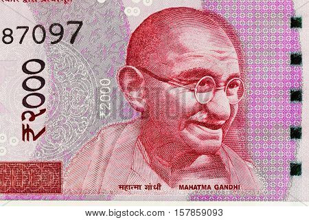 Closeup macro view of Mahatma Gandhi on the new Indian currency note of 2000 Rupees denomination. Mahatma Gandhi known as Father of India Nation on Indian Rupee Currency