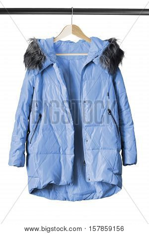 Blue down jacket on wooden clothes rack isolated over white
