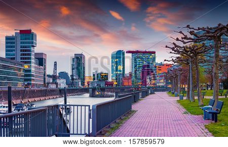 Colorful spring sunset on Rhine in Dusseldorf. Medienhafen in the soft evening light Nordrhein-Westfalen Germany Europe.