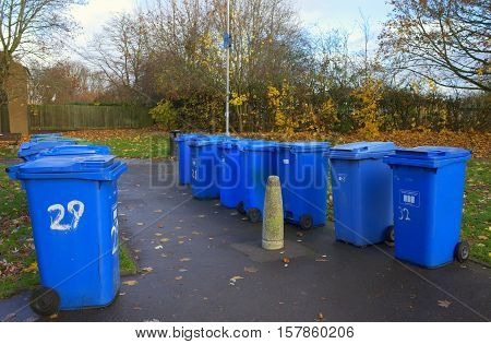 Bracknell,England - November 22, 2016: Blue wheelie bins provided for household waste that can be recycled await collection in Bracknell,England
