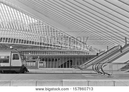 LIEGE BELGIUM - December 2014: View on escalators in the Liege-Guillemins railway station designed by Santiago Calatrava. Black and white photograph