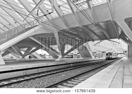 LIEGE BELGIUM - December 2014: The Liege-Guillemins railway station. This station is made of steel glass and white concrete designed by Spanish architect Santiago Calatrava. Black and white photograph