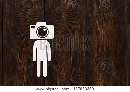 Paper man with photo camera instead of head, photograper or cameraman concept, abstract conceptual image, copyspace