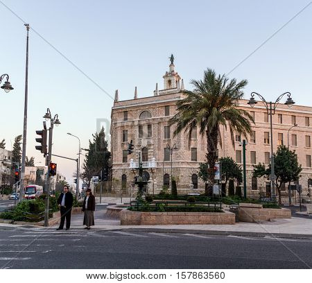 JERUSALEM ISRAEL - FEBRUARY 26: The building of the Terra Sancta College on its roof is a statue of the Madonna on Paris Square in sunset light in Jerusalem Israel on February 26 2016