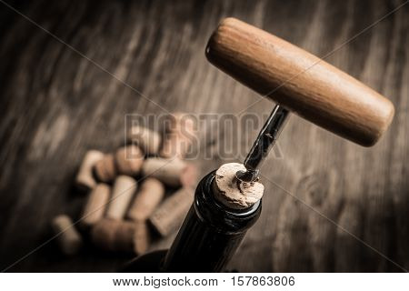 Bottle Of Wine And Cork And Corkscrew On Wooden Table
