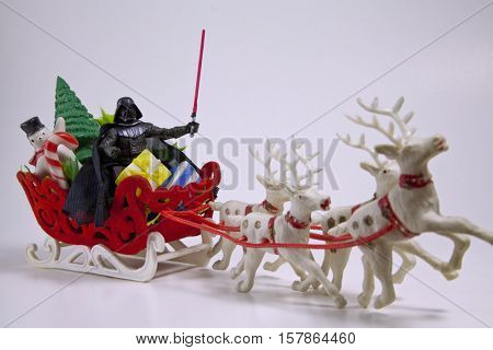 Star Wars Darth Vader action figure recreates a Christmas scene as Santa Claus and his reindeer.