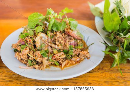 duck mince with spicy taste Thai food (Larb ped) on wood table