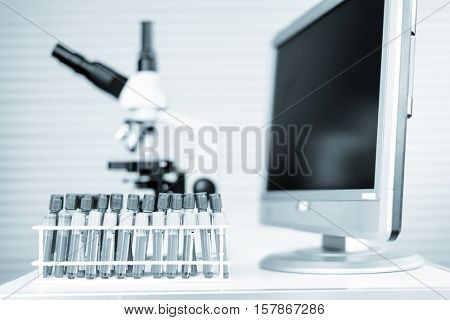 blood test in medical laboratory bench with microscope. Toned Image