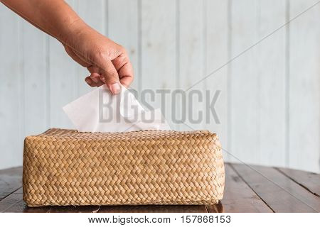 Hand Picking White Piece Tissue Paper From Box