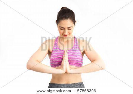 Namaste Posture! Woman In Sports Bra Performing Signature Namaste Yoga Practice Pose - Pilates, Yoga