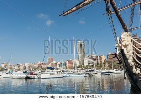 Alicante, Spain - September 9, 2016;  Marina and luxury boats with city skyline. Alicante Spain