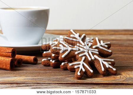 Closeup Gingerbread Cookies, Cinnamon And Cup Of Coffee