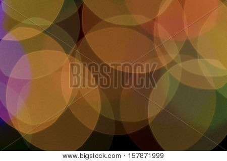 Bokeh vague colorful big yellow scattered celebration christmas lights on black background