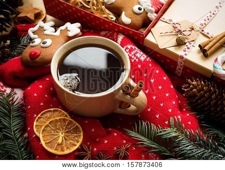 Hot christmas tea with spices and christmas gingerbread. Christmas still life. Overhead view