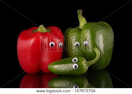 A family of peppers, humorously posed.