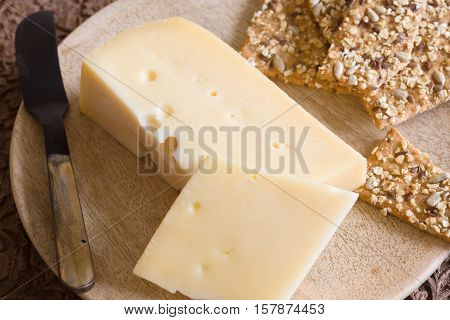 Jarlsberg a mild creamy Norwegian cheese similar to Swiss Emmental with its characteristic holes