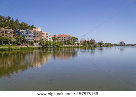Buildings Reflecting On The Lake In Torres