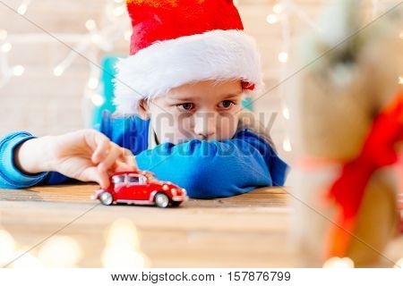 Child Playing With Toy From Santa Claus At Home