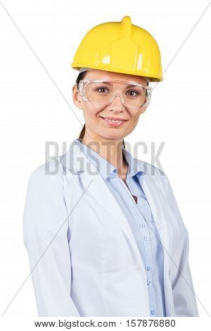 young girl wearing hard hat, goggles, and lab coat