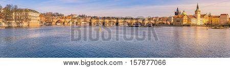 City panorama with the Vltava river in Prague - Cityscape with the Charles Bridge the Vltava river and the historical buildings from Prague the capital of Czech Republic on a sunny day of March.