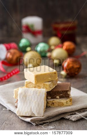 Christmas nougat and christmas decoration on wooden background