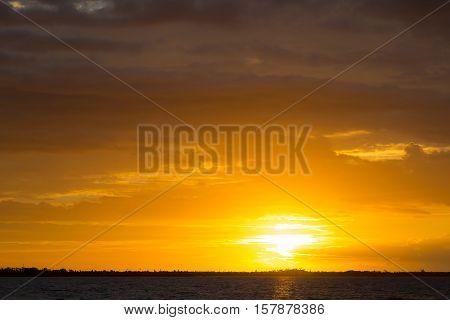Fantastic gold sunset on the ocean beach - seascape. Islands Fiji.