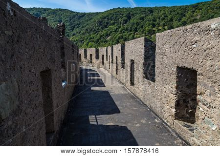 Fragment with battlements of fortress wall. Inner hallway. Reichenstein Castle Rhine Valley Germany - UNESCO World Heritage