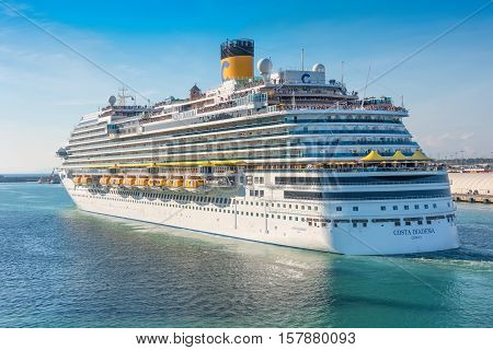 Rome Italy - June 102016: Passengers aboard the Costa Diadema cruise ship gather on deck for the departure from the port of Rome Italy.