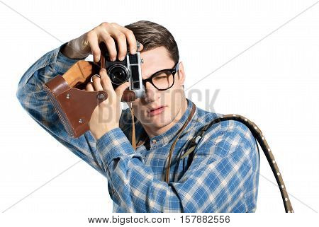 young, handsome man with a camera, dressed in the style of a hipster